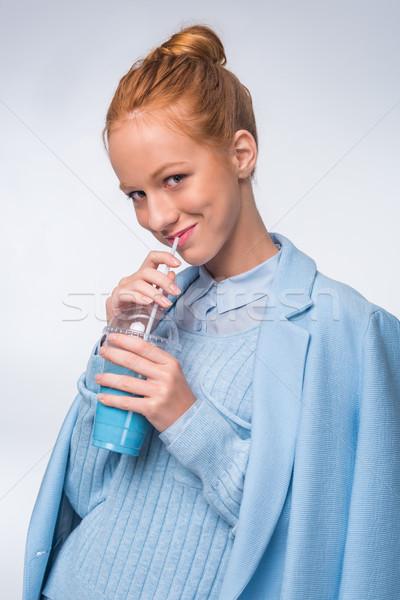 Dziewczyna pitnej niebieski napój atrakcyjny elegancki Zdjęcia stock © LightFieldStudios