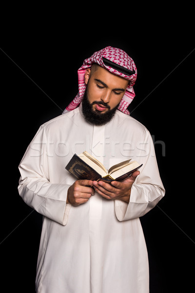 muslim man reading quran Stock photo © LightFieldStudios