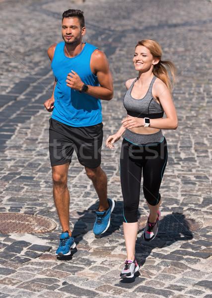 Sport paar jogging stad atletisch Stockfoto © LightFieldStudios