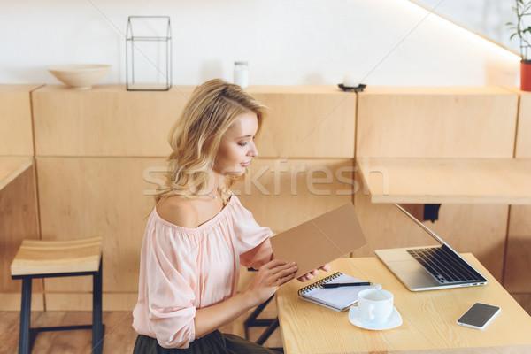женщину чтение меню вид сбоку красивой Сток-фото © LightFieldStudios