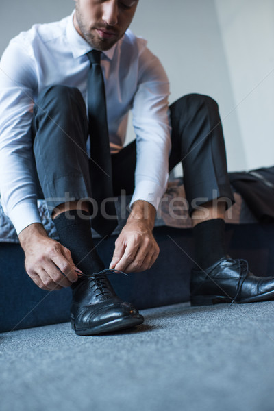Businessman tying shoelaces Stock photo © LightFieldStudios
