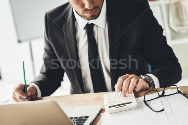 Ragioniere shot mutui laptop ufficio lavoro Foto d'archivio © LightFieldStudios