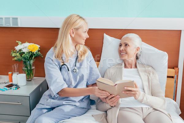 nurse and senior patient with book Stock photo © LightFieldStudios