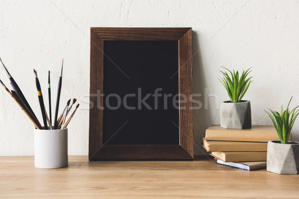 Stock photo: photo frame and book on tabletop
