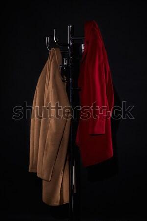 Twee jas rack geïsoleerd zwarte mode Stockfoto © LightFieldStudios