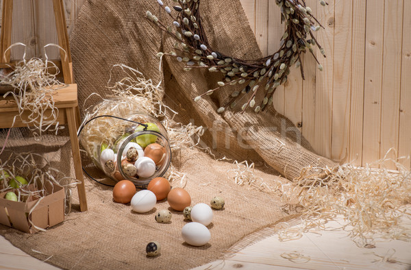 Chicken and quail eggs Stock photo © LightFieldStudios