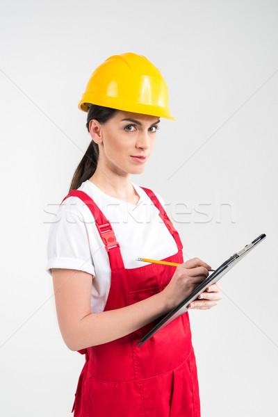 Kadın mühendis kask yazı bakıyor Stok fotoğraf © LightFieldStudios