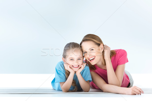 portrait of cheerful daughter and mother on white Stock photo © LightFieldStudios