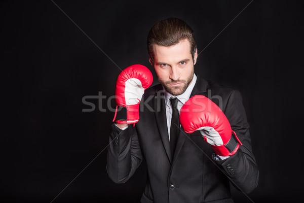 бизнесмен боксерские перчатки молодые красный глядя камеры Сток-фото © LightFieldStudios