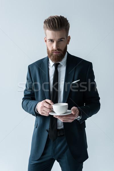 Stylish bärtigen Geschäftsmann halten Kaffeetasse schauen Stock foto © LightFieldStudios