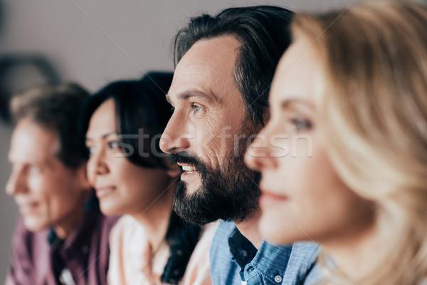 W średnim wieku znajomych widok z boku mężczyzna kobiet Zdjęcia stock © LightFieldStudios