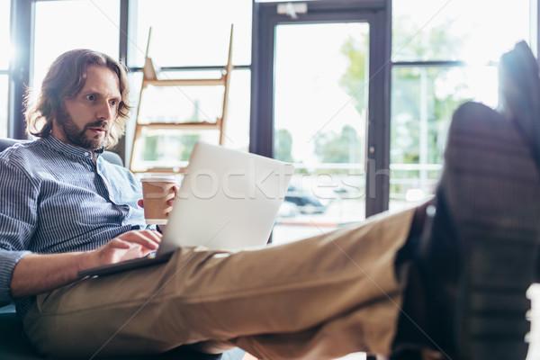 man using laptop Stock photo © LightFieldStudios