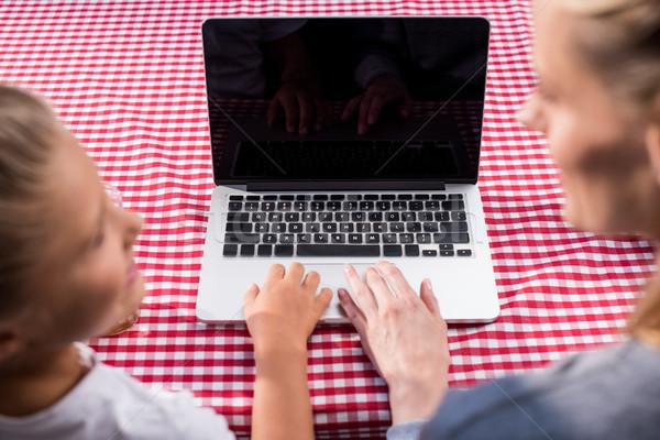 family using laptop Stock photo © LightFieldStudios