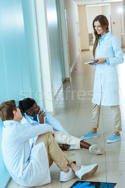 doctors sitting in hospital corridor Stock photo © LightFieldStudios