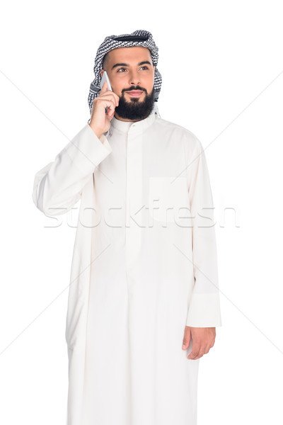 muslim man talking by phone Stock photo © LightFieldStudios