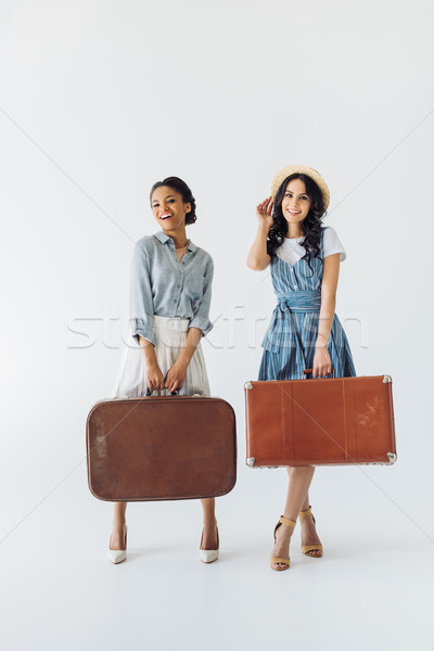 multiethnic women with luggage Stock photo © LightFieldStudios