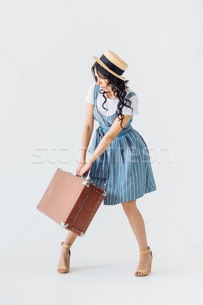 Stock photo: woman with retro suitcase