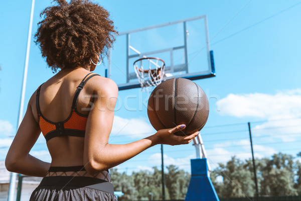 african-american woman holding basketball Stock photo © LightFieldStudios