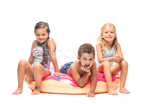 multiethnic kids on swim tube  Stock photo © LightFieldStudios