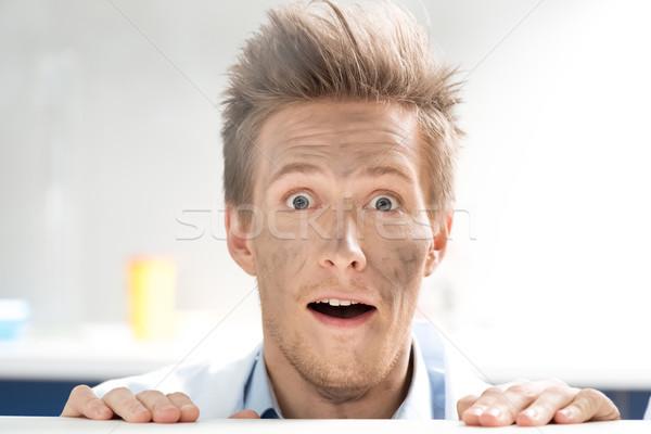 Portret verwonderd wetenschapper naar uit achter Stockfoto © LightFieldStudios