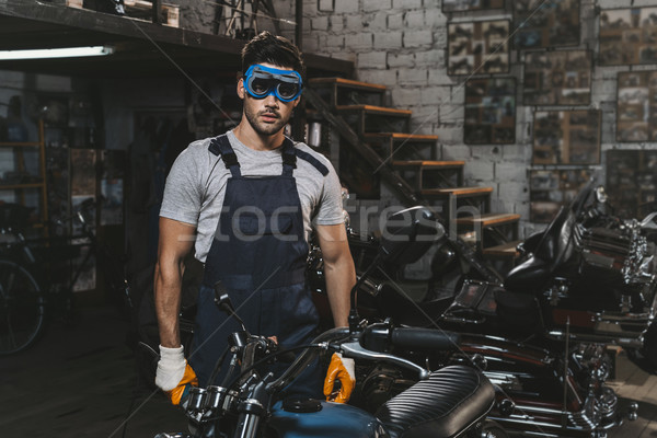 repairman in goggles with motorcycle Stock photo © LightFieldStudios