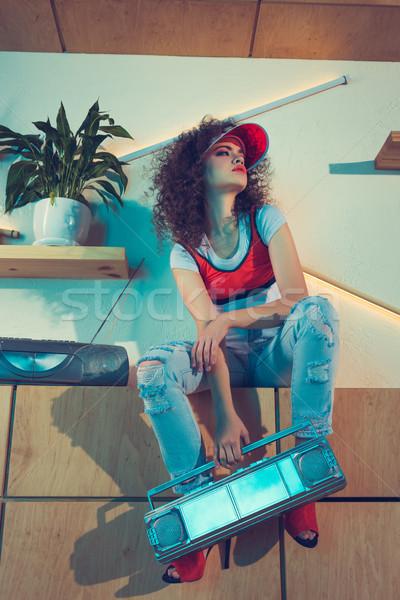stylish woman holding boombox Stock photo © LightFieldStudios