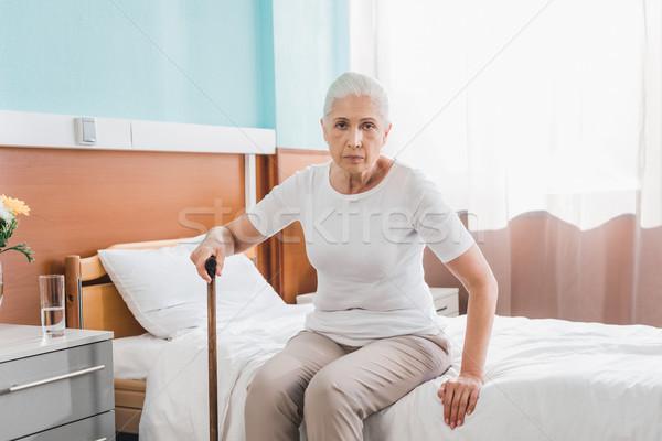 Idős nő sétapálca kórház sétál néz Stock fotó © LightFieldStudios