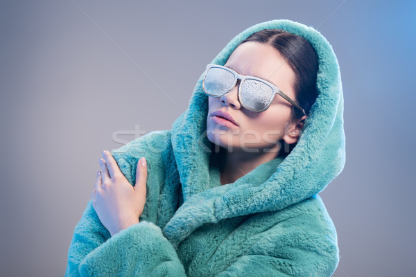 woman with frost on face wearing robe Stock photo © LightFieldStudios