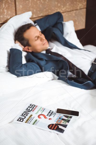 Business newspaper on hotel bed Stock photo © LightFieldStudios