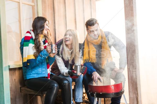 Boldog fiatal barátok iszik forró tea Stock fotó © LightFieldStudios