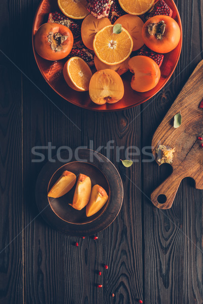 top view of fruits and wooden board on table Stock photo © LightFieldStudios