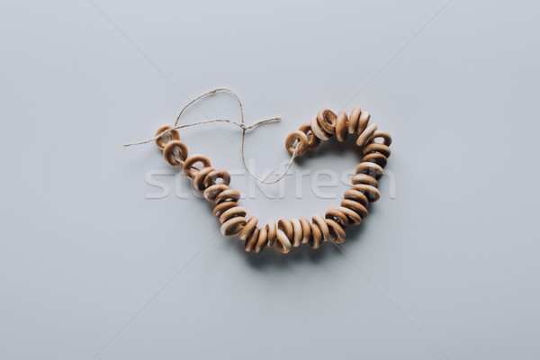top view of sweet tasty bagels on rope isolated on grey Stock photo © LightFieldStudios