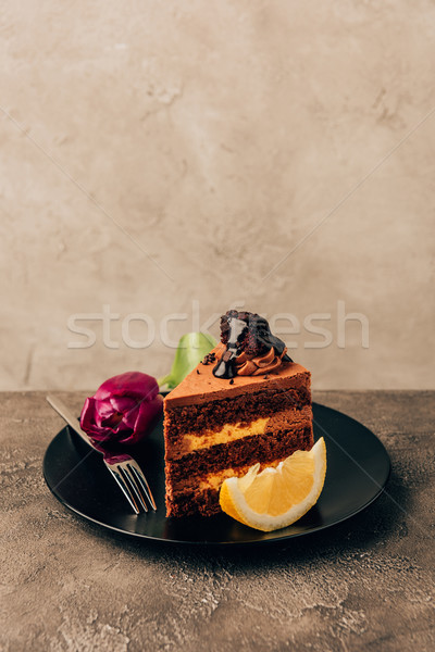 close-up view of delicious chocolate and lemon tart with beautiful tulip flower Stock photo © LightFieldStudios
