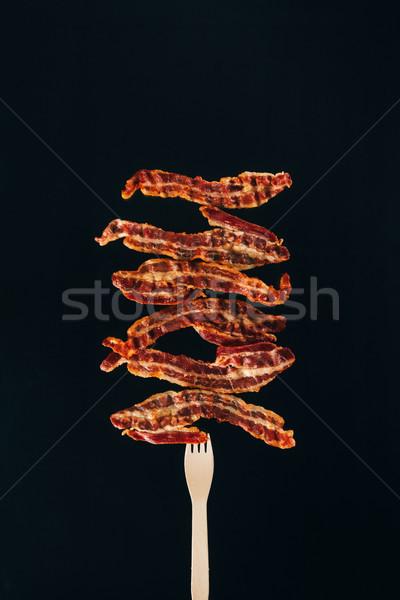 Stukken spek vork geïsoleerd Stockfoto © LightFieldStudios