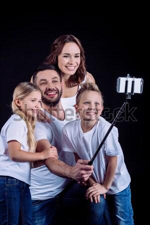 Glückliche Familie ein Kind Porträt schauen Kamera Stock foto © LightFieldStudios