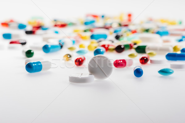 Close-up view of colorful medical pills on white, medicine and healthcare concept      Stock photo © LightFieldStudios
