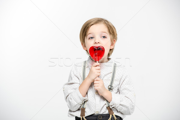Zdjęcia stock: Chłopca · serca · lizak · mały · jedzenie