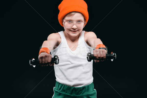 boy training with dumbbells isolated on black. athletics children concept Stock photo © LightFieldStudios