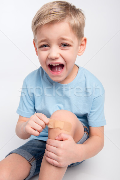 Little boy with patch on knee Stock photo © LightFieldStudios