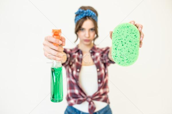 Nő spray üveg szivacs fiatal vonzó nő Stock fotó © LightFieldStudios