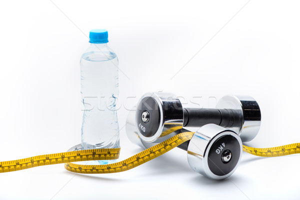 metallic dumbbells, bottle and measuring tape isolated on white. drink water, equipment sport and he Stock photo © LightFieldStudios