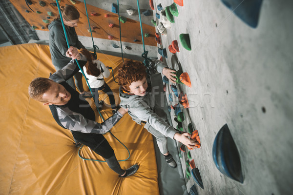 Little boy climbing wall at gym Stock photo © LightFieldStudios