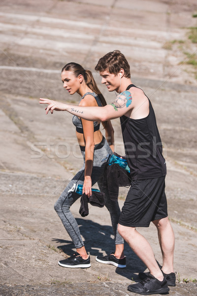 Stock photo: sportive couple walking on slabs