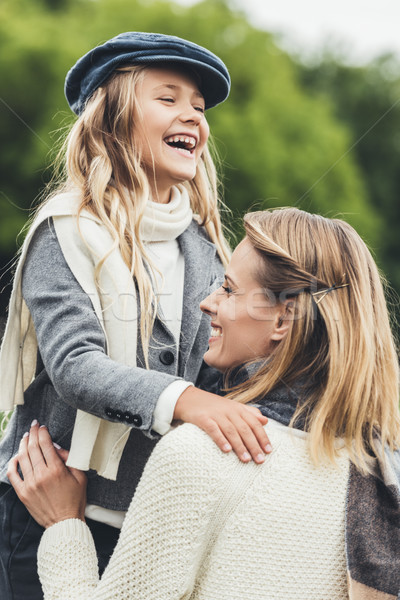 happy mother and daughter Stock photo © LightFieldStudios