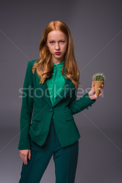 attractive girl with cactus   Stock photo © LightFieldStudios