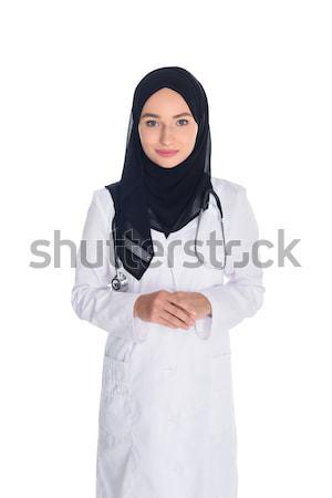 Muszlim orvos fiatal női néz kamera Stock fotó © LightFieldStudios