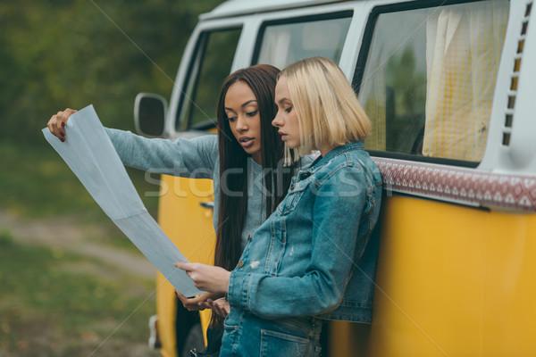 multiethnic girls looking at map Stock photo © LightFieldStudios