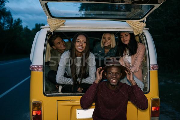 multiethnic friends traveling on minivan Stock photo © LightFieldStudios