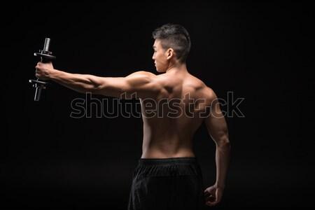 Forte homem músculos retrato isolado Foto stock © LightFieldStudios