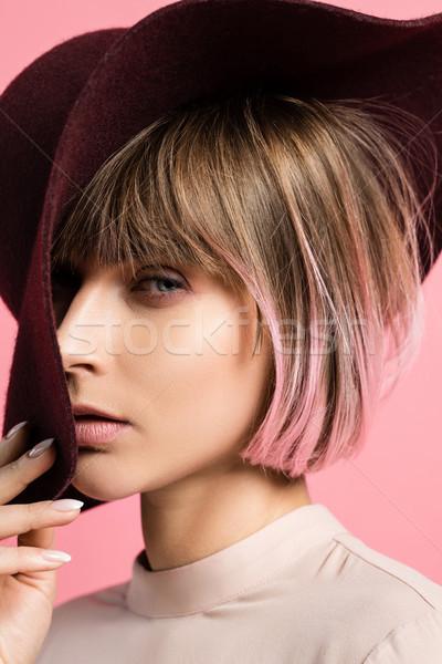 fashionable woman in wide-brimmed hat Stock photo © LightFieldStudios